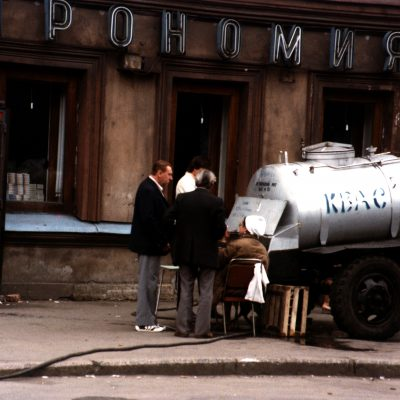 25.	Kvas seller. View down Maklina Prospect looking north from Pl. Turgenev Square, Leningrad. 23 June 1985