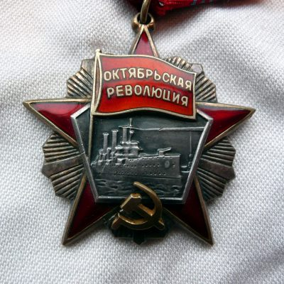 34.	Order of the October Revolution. Established in 1967. Awarded 100,00 times. Gold, silver, gold plating and enamel. Designed by V Zaitsev. Awarded for revolutionary activity, for a significant contribution to the establishment and consolidation of Soviet power, gallantry displayed in combat against the enemies of the Soviet state, for the strengthening of peace between peoples.