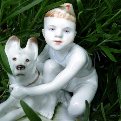 79.Ceramic. Made at the Lomonosov Porcelain Factory, Leningrad. This statue depicts a scene from the poem by Agniya Barto, At The Border Post (На Заставе) (Published 1937 in Moscow and Leningrad by Detgiz) where a boy is rewarded with the gift of an alsation puppy for alerting border guards to a marauder